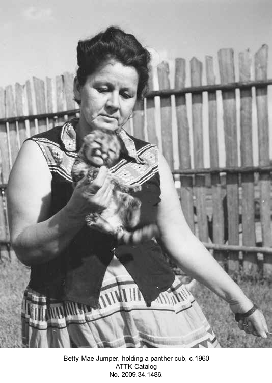 Betty Mae Jumper, holding a panther cub.